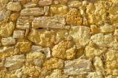 Irregular shapes of a Sandstone wall — Stock Photo