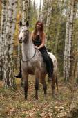 Young girl with appaloosa horse in autumn — Stock Photo