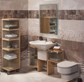 Detail of a modern bathroom with sink, cabinet for towels and to — Fotografia Stock