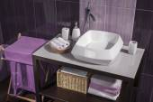 Detail of a modern bathroom with white sink and accessories — Stock Photo