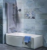 Interior bathroom with tub, shower and accessories — Stock Photo
