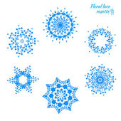 Set of laced snowflakes — Stock Vector