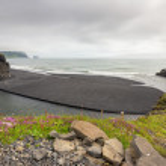 Black volcanic sand beach — Stock Photo #55519799