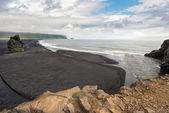 Black volcanic sand beach — Photo