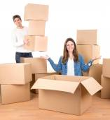 Couple with boxes moving into home — Stock Photo