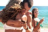 Betrayal on beach — Stock Photo