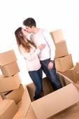Happy couple with boxes — Stock Photo