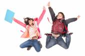 Two jumping children on white — Stock Photo