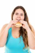 Large girl eating a burger — Stock Photo