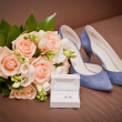 Bridal bouquet, shoes, wedding ring in a box — Stock Photo