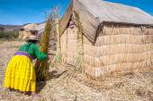 Unrecognizable woman in national costume Indian Uros knits a she — Stock Photo