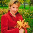 Portrait of woman in autumn leaves — Stock Photo #59386309