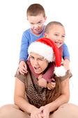 Woman with boys on Christmas — Stock Photo