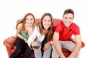Friends sitting on a couch — Stock Photo