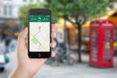 Map gps navigation application on the smartphone screen in femal — Stock Photo