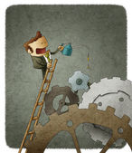 Businessman oiling cogs — Stock Photo
