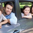 Family sitting in the car — Stock Photo #51818173