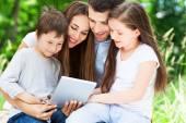 Family using digital tablet — Stock Photo