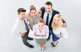 Young business people joining hands in circle — Foto de Stock