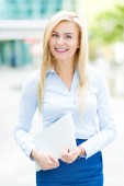 Young businesswoman holding laptop — Stock Photo