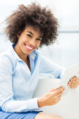 African american woman holding digital tablet — Stock Photo