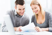 Young couple working together — Stock Photo