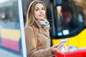 Woman Waiting at Bus Stop — Stock Photo