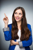 Beautiful woman pointing finger — Stock Photo