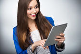 Woman looking at digital tablet — Stock Photo