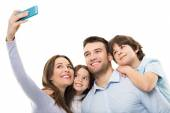 Young family doing selfie — Stock Photo