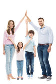 Family forming shape of home — Stock Photo