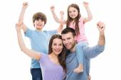 Excited family with raised arms — Stock Photo
