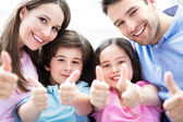 Family with thumbs up — Stock Photo