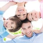 Happy young family having fun — Stock Photo #76180837