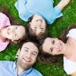 Happy family on grass, top view — Stock Photo #76181103