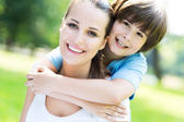 Mother and little son hugging — Stock Photo