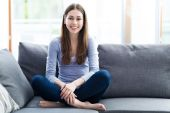 Woman relaxing on sofa — Stock Photo