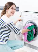 Woman loading washing machine — Stock Photo