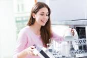 Woman loading dishwasher — Stock Photo