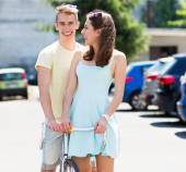 Young couple with bike — Stock Photo
