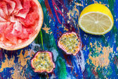 Passion fruit, lemon and grapefruit halves on a colorful backgro — Stock Photo