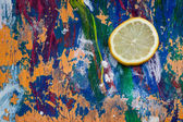 Lemon slice on colourful background — Stock Photo