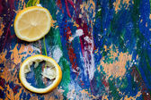 Lemon parts on a colourful background — Stock Photo