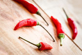 Arrangement of red  chilipeppers — Stock Photo