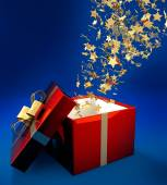 Golden stars coming out of a gift package — Stockfoto