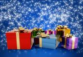 Set of colored gift packages on starry background — Stock Photo