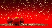 Three christmas balls in a starry background — Stock Photo