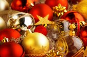 Backdrop of christmas baubles, ribbons and bows — Stock Photo
