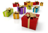 Set of colorful parcels with golden ribbon — Stockfoto