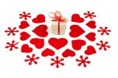 Small gift box and felt decorations on white background — Stock Photo